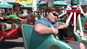 Spinning, Amusement Park Rides, Fun, Leisure. Stock video of spinning rides. Young boys, brothers stock video footage
