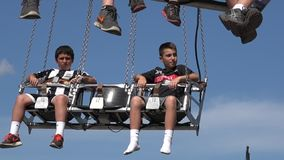 Spinning, Amusement Park Rides, Fun, Leisure. Stock video of spinning rides. Young girls and boys, teens stock footage
