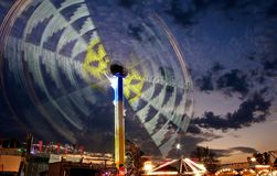 Spinning amusement ride. Light trails of an amusement ride at dusk Stock Photography