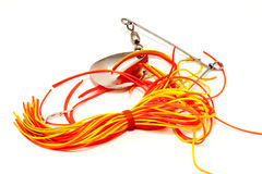 Spinning bait. Rotating blade bait with silver orange and yellow colors for fishing Stock Photos