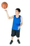 Spinning the ball. Asian Teenage boy playing basketball Stock Photo