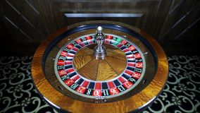 Spinning the ball. American Roulette wheel stock video footage