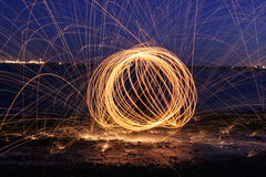 Spinning Ball of Fire. Rotating ball of fire captured on the river mersey shoreline stock photo