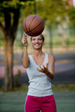 Spinning Basketball. Young athlete spinning basketball, outdoors Stock Images