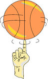 Spinning a basketball. Finger of a person's hand spins a basketball Royalty Free Stock Photography