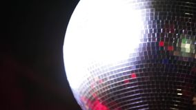 Spinning beautiful night disco ball shining and flashing in vintage or modern club on Black Background. stock footage