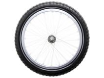 Spinning bicycle wheel Stock Photo