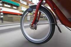 Spinning bicycle wheel stock photography