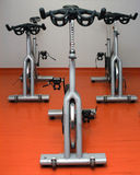 Spinning bicycles Stock Images
