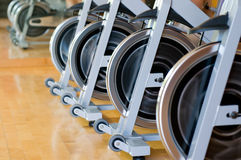 Spinning bicycles closeup Royalty Free Stock Photo