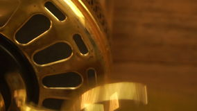 Spinning the big gold fan stock footage