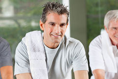 Spinning bike class in fitness Stock Photo