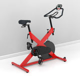 Spinning bike at home. Red spinning bike at home in the training room Royalty Free Stock Image