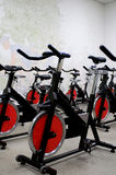 Spinning bikes. Classroom of stationary spinning bicycles royalty free stock photo