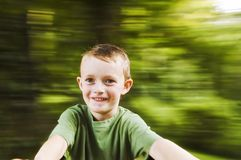 Spinning boy 2. Spinning boy with blurred background and plenty of copy space Royalty Free Stock Image