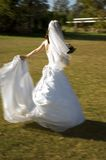 Spinning Bride. Motion added to image to illustrate a dancing bride royalty free stock photos