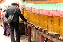 Spinning the buddhist prayer wheel Royalty Free Stock Image