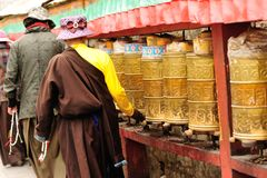 Spinning the buddhist prayer wheel Stock Photography