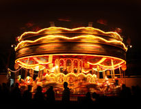 Spinning carousel lights Royalty Free Stock Photo