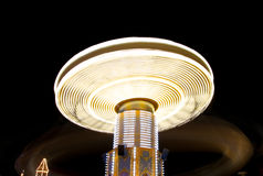 Spinning carousel at night Stock Image