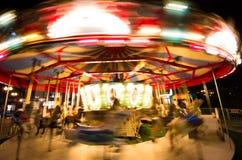 Spinning carousel at night Stock Image