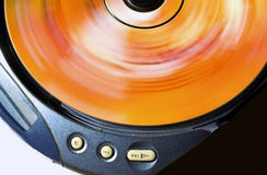 Spinning CD. Spinning compact disc in a portable cd player, play concept stock images