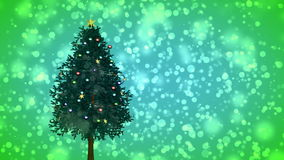 Spinning Christmas tree on green background stock video footage