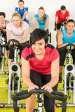 Spinning class sport people exercise at gym. Enjoy workout Royalty Free Stock Photos