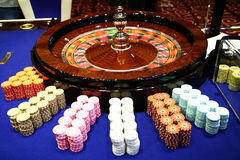 Spinning classic roulette and chips. Spinning classic roulette table with chips Stock Image