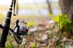 Spinning with a coil on the shore. Evening fishing Stock Photography