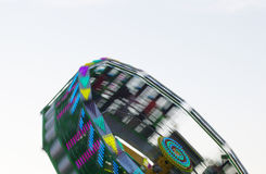 Spinning, colourful amusement ride stock photos