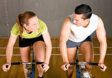 Spinning couple in gym Royalty Free Stock Photos