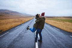 Spinning Couple on Road in Iceland. Couple spinning in middle of road in Iceland field Royalty Free Stock Image