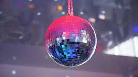 Disco ball with bright rays. Spinning disco ball with bright rays at the party. Party lights of disco ball stock video footage
