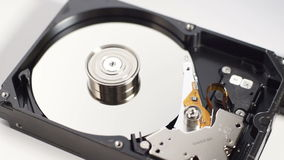 Spinning disk drive with pin head reader reading data stock video