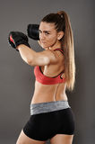 Spinning elbow kickbox girl Stock Images