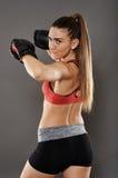 Spinning elbow kickbox girl Stock Images