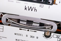 Spinning electric meter dial close-up. Electricity meter dial close-up and showing kilowatt hour royalty free stock photo