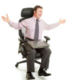 Spinning in Ergonomic Chair. Happy businessman spinning around in his comfortable new ergonomic chair Stock Photos