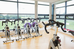 Spinning exercise bikes in gym room Stock Photos