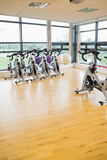 Spinning exercise bikes in gym room Royalty Free Stock Photo