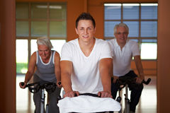 Spinning exercise class in gym Royalty Free Stock Images