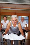 Spinning exercises in gym Royalty Free Stock Photo
