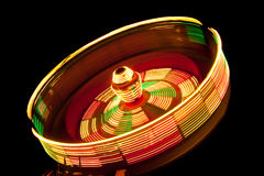 Spinning Fair Ride Lights Stock Photo