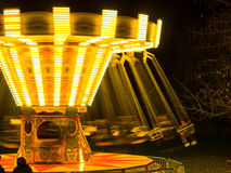 Spinning Fairground Ride. Fairground ride spinning around at night Royalty Free Stock Photo