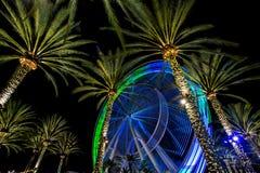 Spinning ferris wheel Stock Images