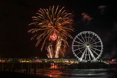 Spinning Ferris Wheel and international fireworks competition at the beach in Scheveningen, the Netherlands stock images