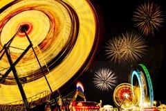 Spinning ferris wheels at night Stock Photos