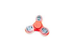 Spinning Fidget Spinner. Red spinning fidget spinner toy Royalty Free Stock Photography