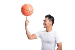 Spinning on finger. Isolated image of a basketball player spinning a ball on finger Royalty Free Stock Images